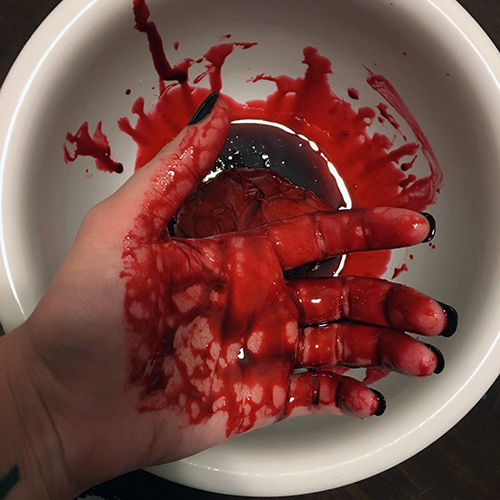 My hands in fake blood for Halloween